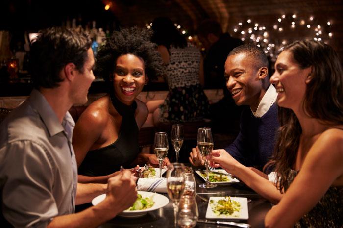 Customers at table using iPad